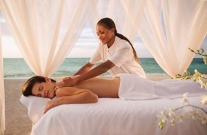 Massage on the beach at Breezes Runaway Bay